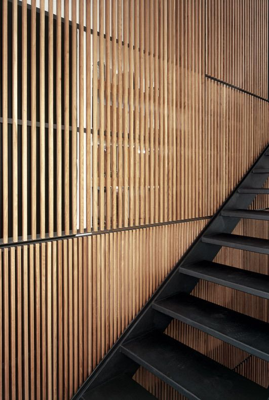 Metal staircase + wooden claustra wall.  Canyon House by LABICS