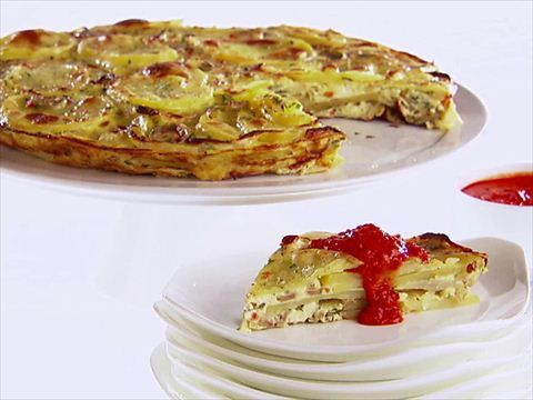Spanish Potato Omelet Recipe : Giada De Laurentiis : Food Network (to veganize…I'm doing it without the eggs, so not really an omelet)