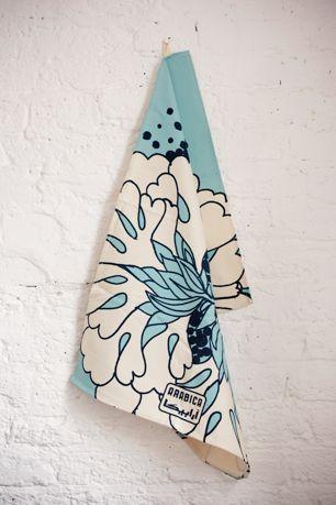 Screen printed cotton Arabica Carella kitchen tea towel.  Made in England
