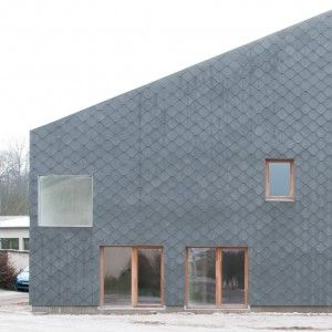Cement+shingles+create+scaly+facade+for+French+barn+conversion+by+GENS