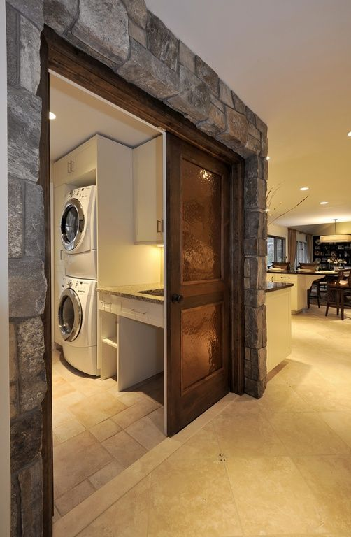 Rustic Laundry Room With Natural Stone Wall, Sliding Barn