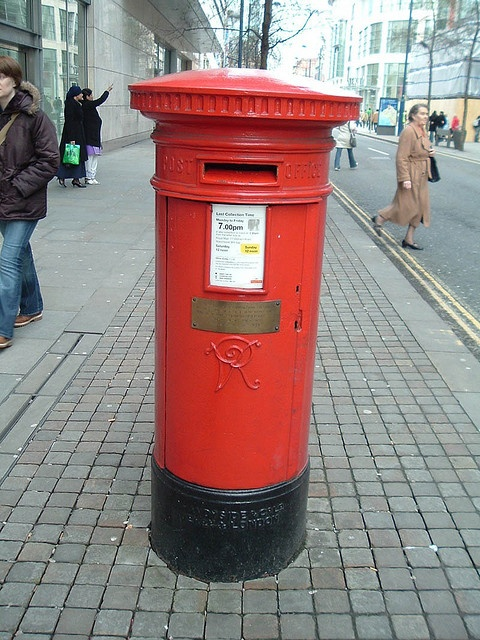 Post box outside Manchester's M, which survived the 1996 IRA bomb almost unscathed while everything in the surrounded area was devastated, and now wears a plaque commemorating its history.