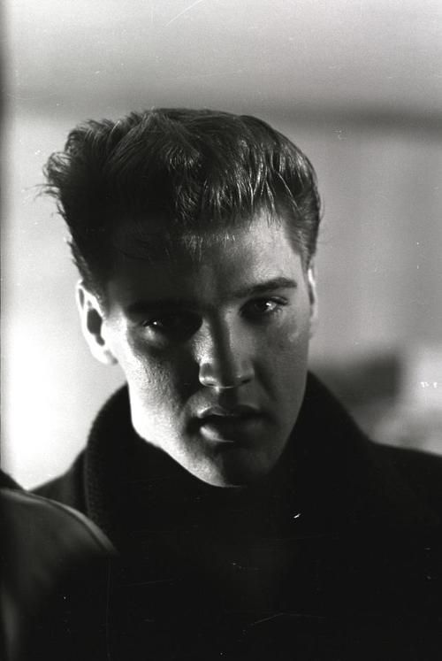 """This shot of the King of Rock Roll was taken in Memphis, Tennessee, on March 15, 1960: Elvis had just returned to the U.S. from his stint in Germany with the army, which clearly had not done permanent damage to his amazing hair. A few days later, Elvis would go into a Memphis studio and cut his first post-army single, the number one hit """"Stuck On You."""""""