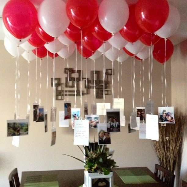 Neat Birthday idea   Loving it!   Pictures of the birthday person hanging from the strings of balloons.