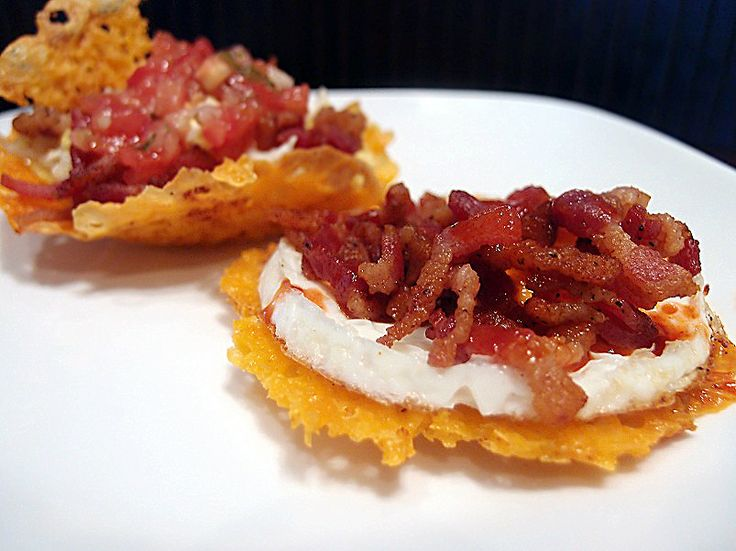 Egg and Bacon Cheese Baskets  Per serving (2 egg baskets) you're looking at: 531 Calories, 51.3g Fats, 4.7g Carbs, and 32.7g Protein.