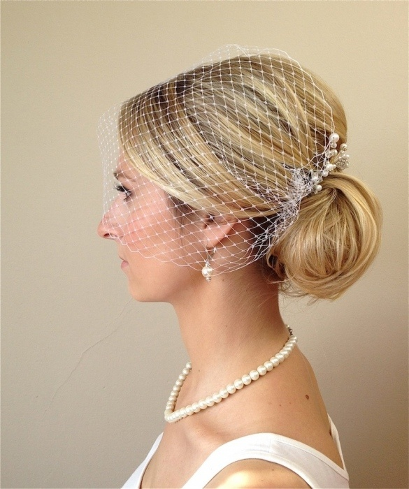 wedding hairstyles - french chignon with bird cage