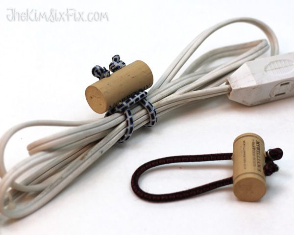 Wine Cork Cord Ties I think I could do a variation of this with a button and an elastic band