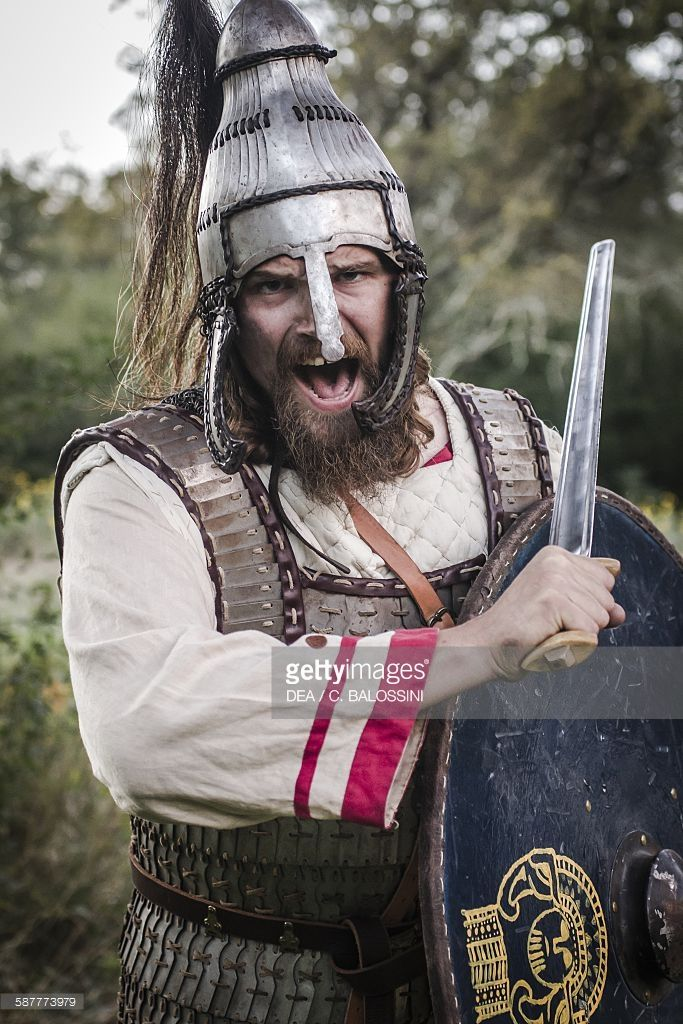 Langobard warrior with Avar lamellar helmet and lamellar armour, reconstruction based on findings in Niederstotzingen (Germany), shield (decorated with motifs from a fibulae found in Cividale del Friuli) and spatha (straight and long sword). Northern Italy, 6th century. Historical reenactment.