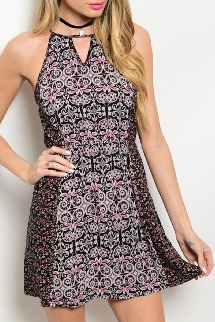 Cute mini dress features a trendy mixed print and neckline and back with keyhole cutouts.  Black/pink Mini Dress by Adore Clothes & More. Washington