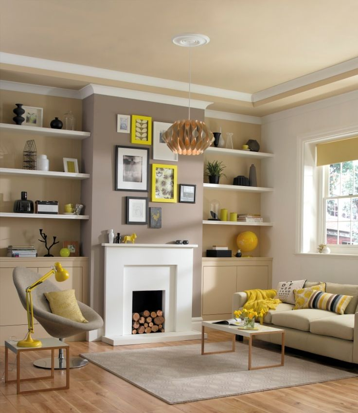 Yellow #accessories bring this stylish #lounge together. Simple clean coving in white draws the eye upwards and makes a real feature of the chimney breast.