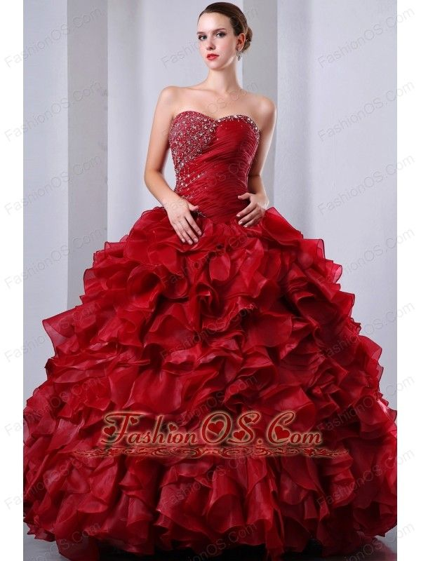 Wine Red A-Line / Princess Sweetheart Beading and Ruffles Quinceanea Dress Floor-length Organza  http://www.fashionos.com  You will be the belle of the ball in this stunning gown. It features a strapless bodice with sweetheart neckline that has been heavily embellished with gorgeous beadwork on the right side of the bust and waist. The ruffled skirt is so gorgeous and it is so beautiful a gown for anyone on any occasion.