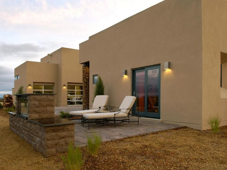 A crushed-stone ground cover complements stones set in exterior pillars and will allow native grasses to seed in the area.