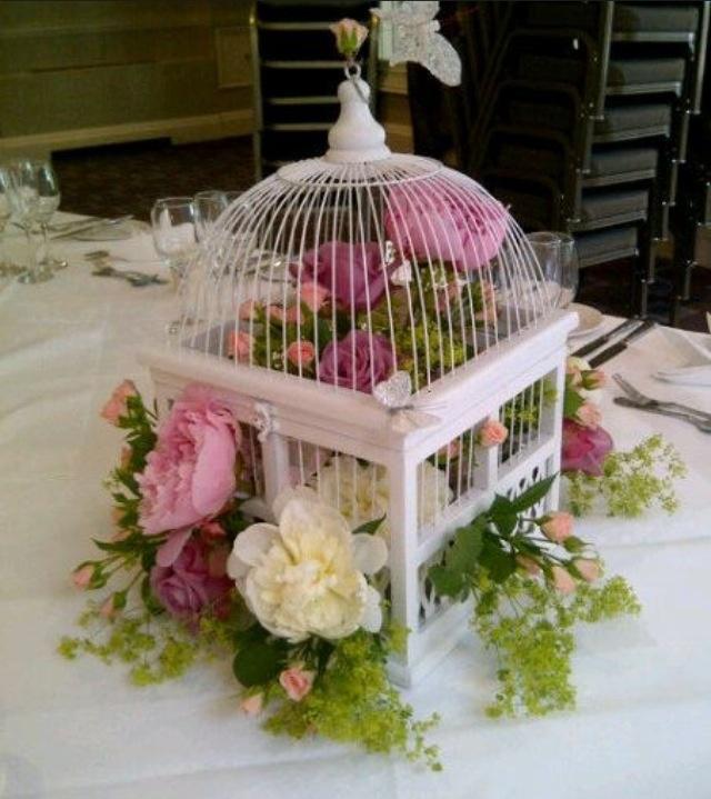 Beautiful table decoration/ wedding flower bird cage flowers