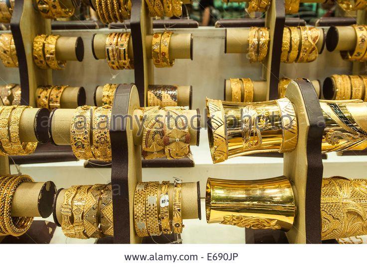 Gold jewelry bracelets in the Deira Gold Souk Market Dubai, United Arab Emirates UAE.