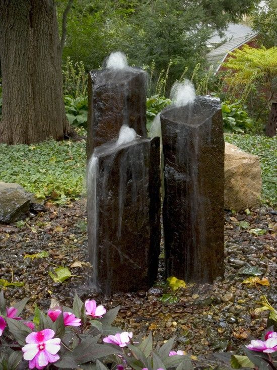 Basalt column fountains fit nicely into a natural landscape, attract birds butterflies, plus it doesn't collect leaves.