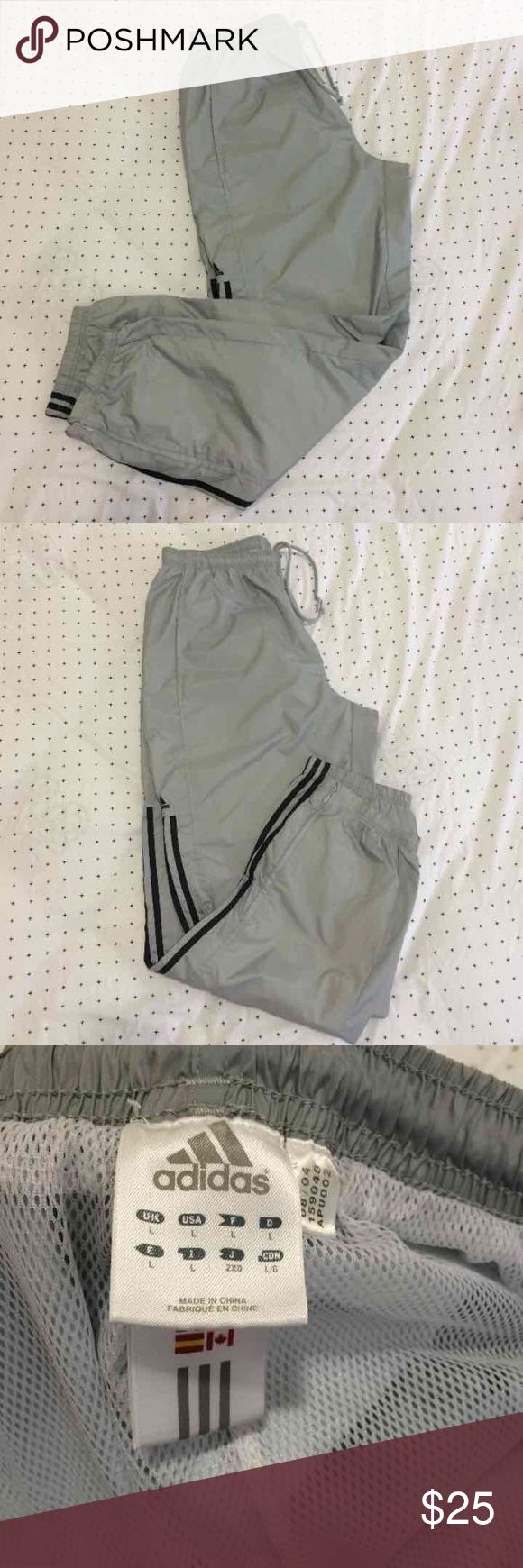 Adidas men's running pants. Gray color size L. Adidas running pants men size L, gray color, never been worn because its too big for my husband. Adidas Pants Track Pants & Joggers