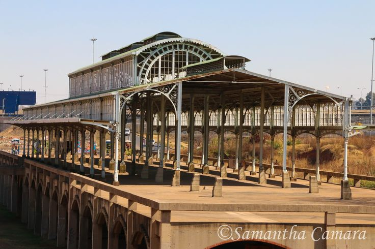 Originally built in 1897, the steel structure of the 'Old Train Station' has been at the corner of Carr & Ntemi Piliso Streets in Newtown since 1995. Plans to turn the station into a transport museum are yet to be realised. It was first dismantled in 1952 & rebuilt in Kempton Park as a training station. Its current placement next to Nelson Mandela Bridge is almost directly in line with the new Johannesburg Park Station, its modern counterpart.