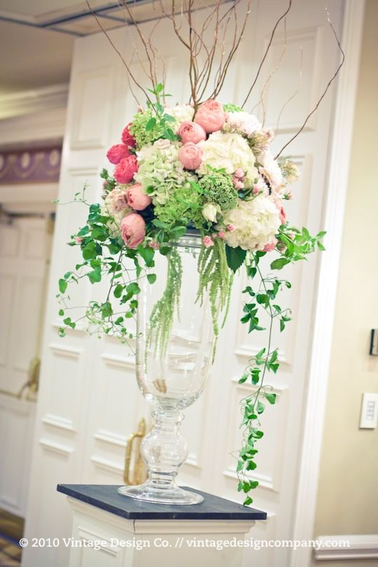 61 best images about tall flower arrangments on pinterest for Wedding reception centrepieces