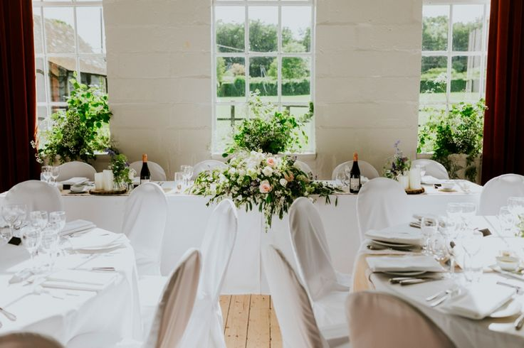 Now that's a top table! Photo by Benjamin Stuart Photography #weddingphotography #weddingflowers #toptable #weddingdecor #freshflowers #flowers #wythamvillagehall #countrywedding