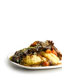 Guinness-Braised Short Ribs!  Mmmmm!  I would add a dash of cocoa, cayenne, and cinnamon too!