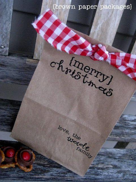 Christmas Paper Bags...super cute, inexpensive. Just pick a font and feed them through your printer at home. Punch a couple of holes, add fabric strip and tie. It's that easy!