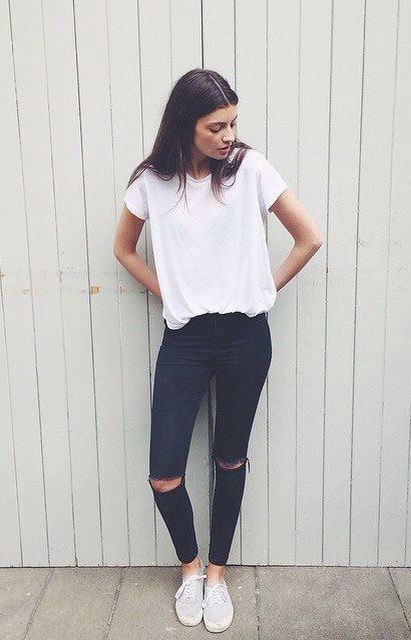 Coldish/ grey or white baggy top, black ripped jeans, grey cardigan blazer…