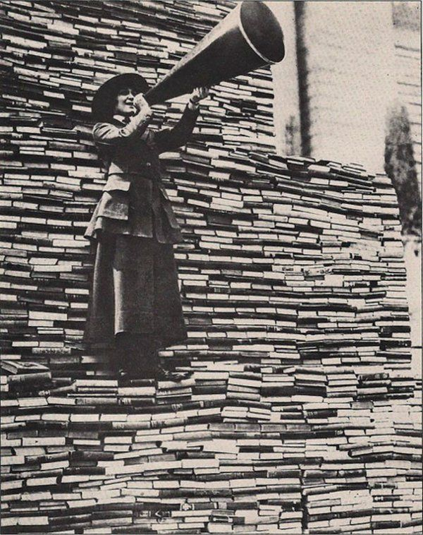 Photo from the 1910s.  A women calls for more books to be donated to the New York public library on 5th Avenue