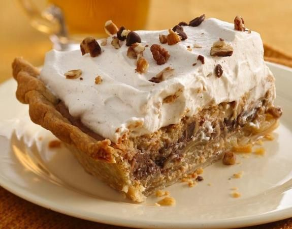 Apple and caramel-cream cheese filling come together in this delicious pie that's made with Pillsbury® pie crust and topped with whipping cream - a wonderful dessert.#widget
