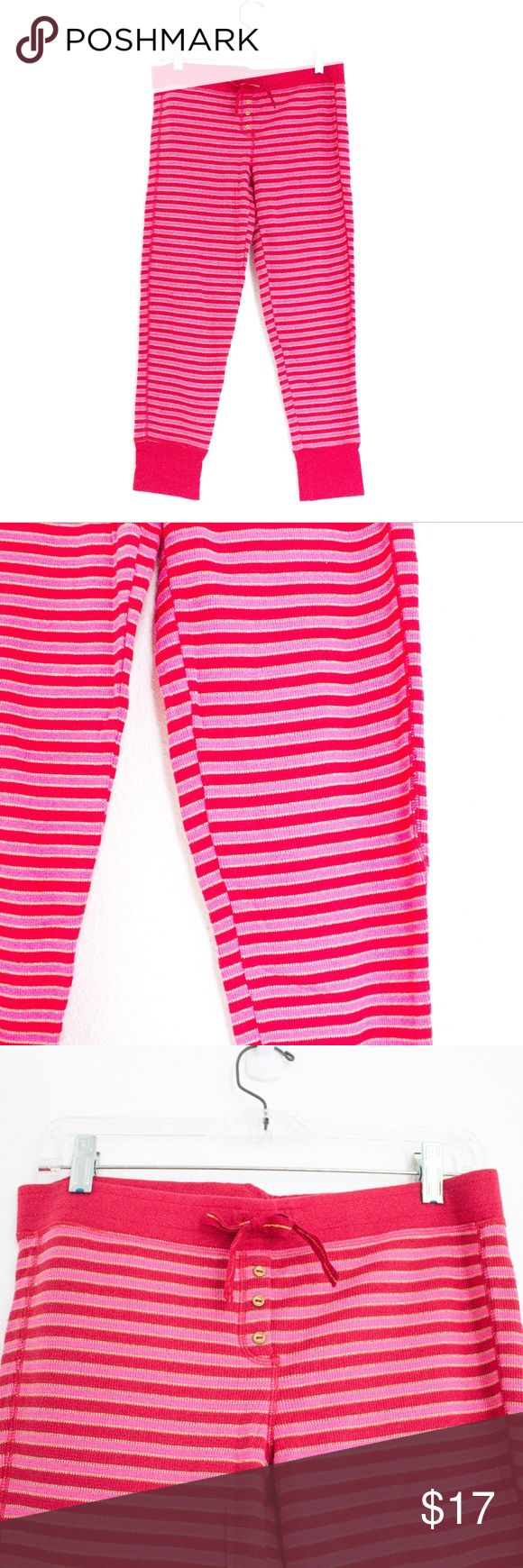 [Victoria's Secret] Red Pink Stripe Thermal PJs M VICTORIAS SECRET Women's Red Pink Gold Stripe Cropped Thermal PJ Pants Sz M  These adorable pj/lounge pants have a red waist band with red and pink stripes that are outlined with gold. These have a thermal or waffle like pattern and have a stretchy ankle band at the bottom of the legs. Additionally, there is a drawstring for extra comfort and hold. Item has a small pin hole on the right front waistband (see photos) but overall EUC…