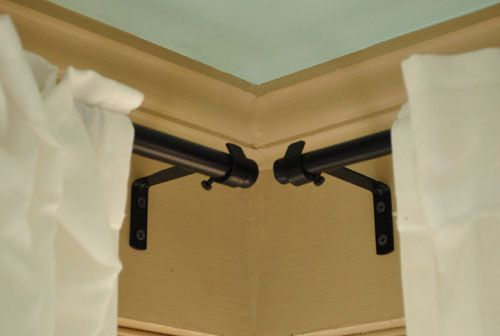 Our Sunroom Mini Makeover: Phase Two   Young House Love - long curtain rods mimic corner