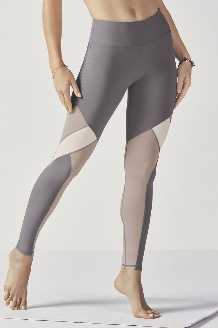 Show off some shimmer in our mixed media leggings with high-shine fabric and breezy mesh panels all in one. Enjoy superior technology with all-way stretch, moisture-control features and UPF 50+ sun protection. | Fabletics Breann Legging