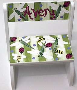 Personalized Step Stool ~ Bugs ~ A hand painted wooden step stool/chair that is perfect for little ones to stand on to wash hands, brush teeth, etc; personalized with first name to make a unique, treasured baby gift.  $58.95 from ivyrosegifts.com