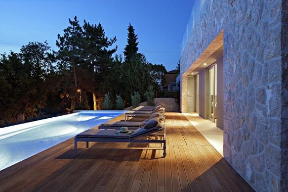 House in Croatia by seashore with pool.