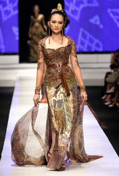 Modern Malaysian kebaya from anne avantie's collection. love the beautiful colors.