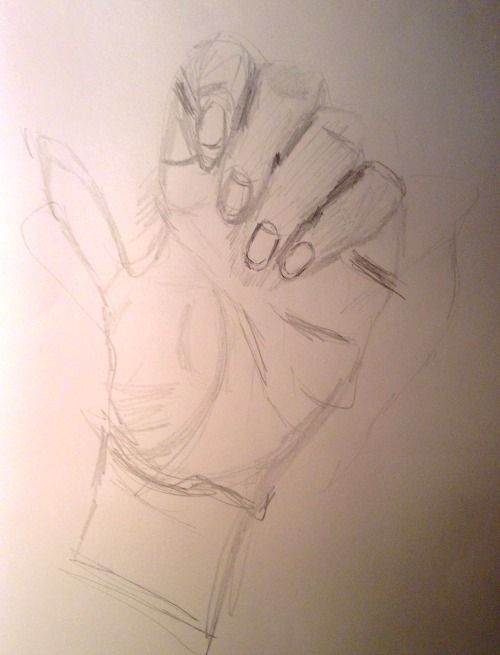 Mia's drawing of her hand before instruction.