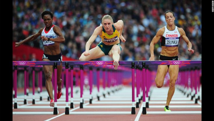 Sally Pearson of Australia leads Tiffany Porter of Great Britain and Jessica Zelinka of Canada in the women's 100-meter hurdles semifinals.  London Olympics 2012 Day 11