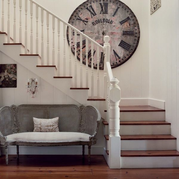 European Stairs Deign with Big Retro Wall Clock as Decorations