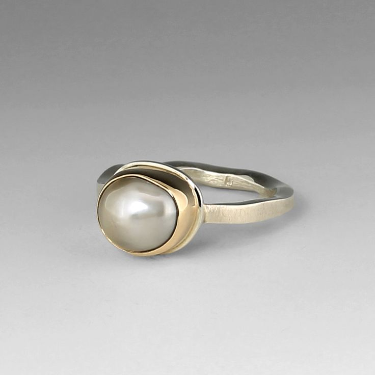 Tahitian Pearl Ring by  Jamie Joseph  |  The light grey pearl is set in a 14k gold bezel on a sterling silver 'Live Edge' band. $700.00
