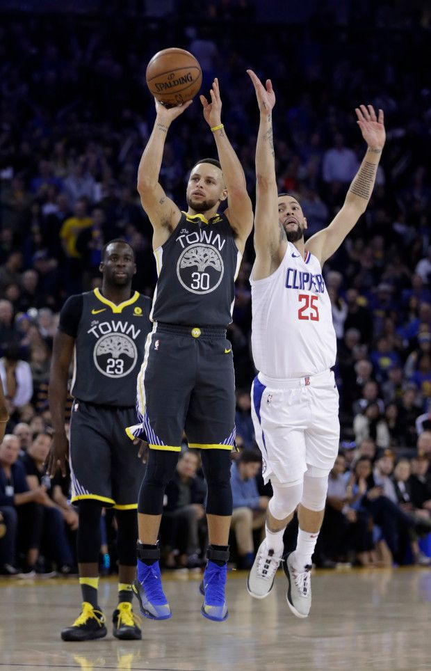 Golden State Warriors' Stephen Curry (30) shoots past Los Angeles Clippers guard Austin Rivers (25) during the second half of an NBA basketball game Thursday, Feb. 22, 2018, in Oakland, Calif. (AP Photo/Marcio Jose Sanchez)