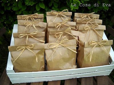 Inspiration photo. Kraft paper bags with folded top and raffia ribbon bow.