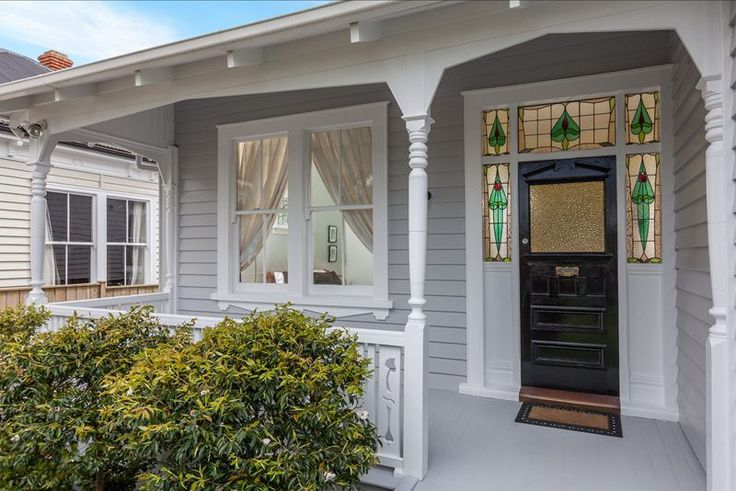 Pretty stained glass front door surrounds at 3 bedroom wooden villa, Herbert Rd, Mt Eden. (For sale @ 2 million NZD, Nov 2012.)