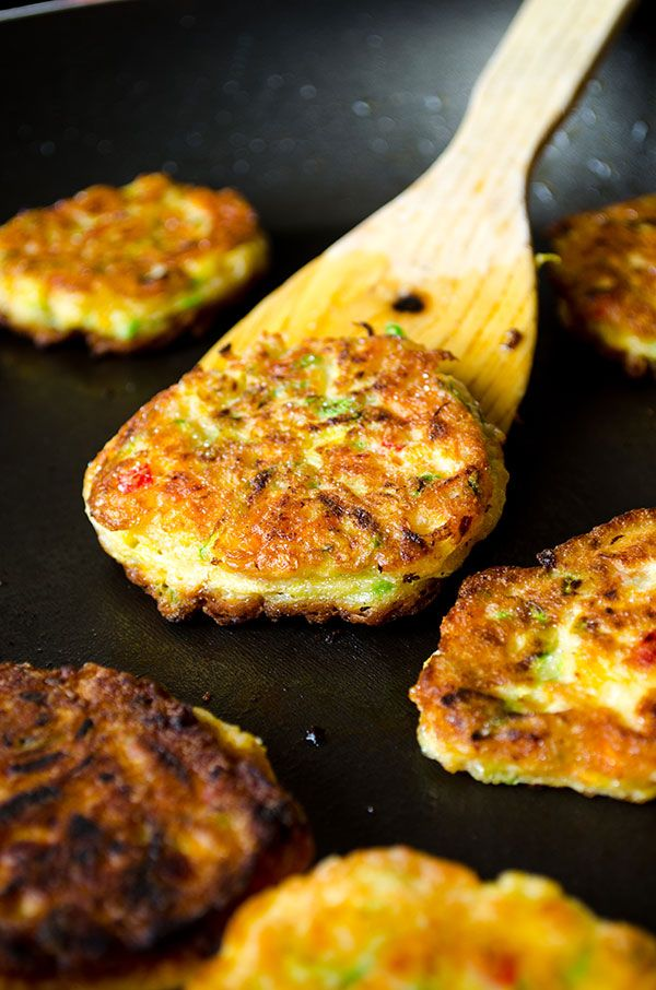Zucchini fritters with carrot, red bell pepper and feta. You can even make vegetarian burgers with these.