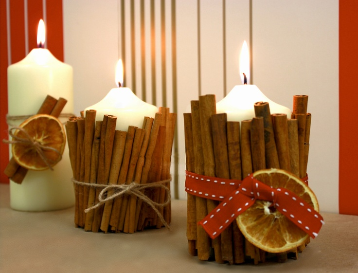 Cinnamon Candles.   Made with cinnamon, orange slices, ribbon and twine.