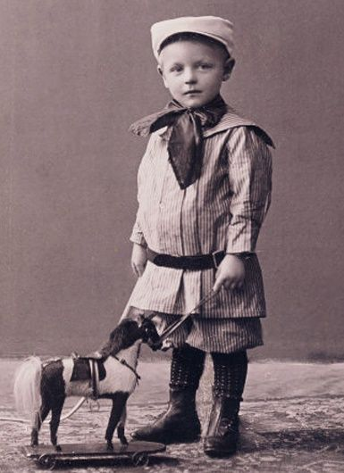 Boy with Horse Pull Toy
