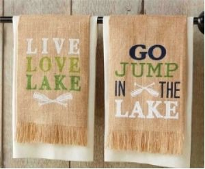 """Set of two burlap hand towels, each with a lake saying screen printed on their face. One towel reads """"Go Jump in the Lake"""" and the other """"Live Love Lake."""" The set comes in a presentation box for easy gifting to your favorite lake lover."""