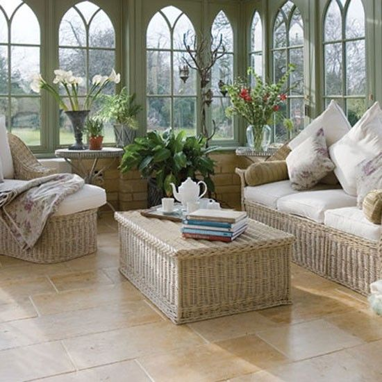 conservatory .   Traditional English willow furniture creates a timeless look in a living room conservatory and complements classical features such as arched windows and open brickwork while also maintaining an informal garden feel. Add plenty of cushions for comfort and relaxation.