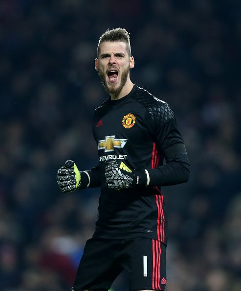 Manchester United's David De Gea celebrates his side going 10 up during the EFL Cup Quarter Final match between Manchester United and West Ham United...