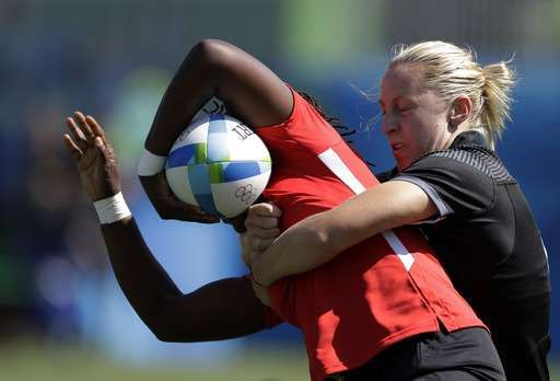 New Zealand's Kelly Brazier, right, tackles Kenya's Doreen Nziwa, during the women's rugby sevens match between New Zealand and Kenya at the Summer Olympics in Rio de Janeiro, Brazil, Saturday, Aug. 6, 2016. (AP Photo/Themba Hadebe)