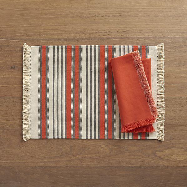 Aspen Stripe Orange Placemat and Aspen Orange Napkin  | Crate and Barrel