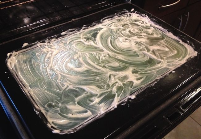 How to Clean Oven Glass - Apply Paste -- 1/2 C. BAKING SODA, A DAB OF WATER, 15 MINS.
